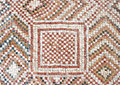 Detail of an ancient colorful mosaic fragment floor small tiles unusual geometric ornament floral and regular forms israel Royalty Free Stock Photo
