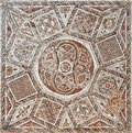 Detail of an ancient colorful mosaic fragment floor small tiles unusual geometric ornament floral and regular forms roman fortress Stock Photography