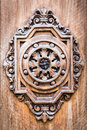 Detail of an ancient wooden door carved. Royalty Free Stock Photo