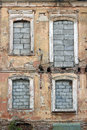 Detail of an ancient and worn wall with brick filled in windows Royalty Free Stock Photo
