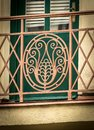 Detail of a beautiful old wrought iron balcony grid Royalty Free Stock Photo