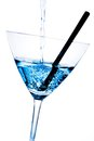 Detail of blue cocktail with bubbles and black straw on a white background Stock Images
