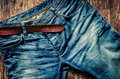 Detail of blue jeans with leather belt in vintage style Royalty Free Stock Photo