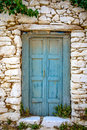 Detail of blue wooden door in vintage stone wall Royalty Free Stock Photo