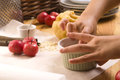 Detail of child hands making apple pie Royalty Free Stock Image