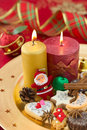 Detail of Christmas cookies with candles Royalty Free Stock Photo
