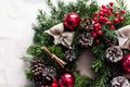 Detail of Christmas wreath with red baubles and berries Royalty Free Stock Photo