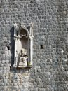 Detail in the city wall of dubrovnik a sculpture a holy figure croatia Royalty Free Stock Images