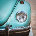 Detail of classic car close up of headlight vintage color tone picture Stock Photo