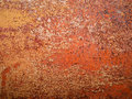 Detail and close up of rust on car metal with cracking, presence of rust and corrosion, beautiful abstract background
