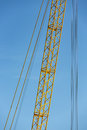 Detail crane jib against a blue sky yellow Stock Images