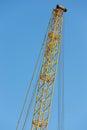 Detail crane jib against a blue sky yellow Stock Photos