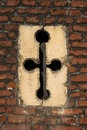 Detail of cross-shaped window slit in Tudor architecture exterio Royalty Free Stock Photo