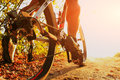Detail of cyclist man feet riding mountain bike on outdoor Royalty Free Stock Photo