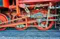 Detail of the drive of a steam locomotive at the train station Royalty Free Stock Photo