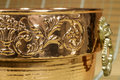 Detail of engraved motifs in a cauldron of copper view decorative object for home Stock Photos