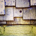 Detail of a filthy yellow wall in wood with different layers Royalty Free Stock Photo