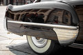 Detail of the front of the right rear of a black vintage car Royalty Free Stock Photo