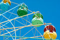Detail giant colorful old carousel ferris wheel blue sky background Stock Photography
