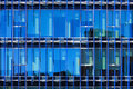 Detail glass facade of a building with solar shading blue Stock Photography