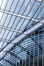 Detail of a glass roof mirroring in a modern skyscraper Royalty Free Stock Photo