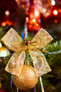 Detail gold ball and ribbon on christmas tree Stock Image
