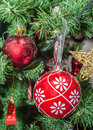 Detail of green Christmas (Chrismas) tree with colored ornaments, globes, stars, Santa Claus, Snowman Royalty Free Stock Photo