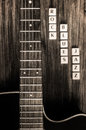 Detail of guitar and signs rock blues jazz in vintage style monochrome Stock Photos