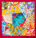 Detail of hand made patchwork quilt in red framing Royalty Free Stock Photo