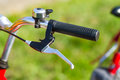 Detail on a handlebar of a bicycle with brake and bell Royalty Free Stock Image