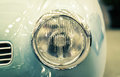Detail on the headlight of a vintage car Royalty Free Stock Photo