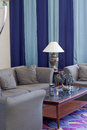 Detail of hotel lobby a living room with lamp sofa and table Royalty Free Stock Photo