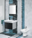 Detail of a luxurious bathroom interior with miror and sink with accessories tiles in three colors Stock Photo