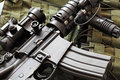 Detail of m a ar carbine and tactical vest scratched green military Stock Image