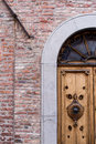 Detail of a main entrance door of an ancient house Royalty Free Stock Photo
