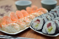 Detail of maki sushi rolls and nigiri sushi with salmon and shrimp japan food on the table with soy sauce and ginger Royalty Free Stock Photo