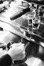 Detail of making espresso coffee with machine bw Royalty Free Stock Photo