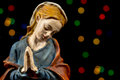 Detail of mary virgin nativity scene figures christmas traditions blessed with colorful stars at background Royalty Free Stock Photos