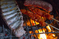 Detail of meat on barbecue fire