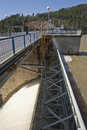 Detail of mechanism of sluice gates to relieve water from the reservoir expulsion after heavy rains in Royalty Free Stock Image