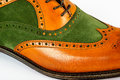 Detail of men s spectator style dress shoe isolated on white Royalty Free Stock Photo