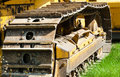 Detail of muddy caterpillar tracks on bulldozer. Royalty Free Stock Photo