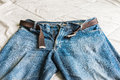 Detail of nice blue jeans with belt Royalty Free Stock Photo