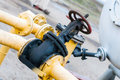 Detail of oil or gas pipeline with valves in large Oil refinery Royalty Free Stock Photo