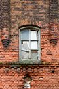 Detail of an old  brick wall with abroken window Royalty Free Stock Photo