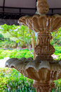 Detail of an old classic style stone fountain with flowing water Royalty Free Stock Photo