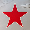 Detail of an old russian jet fighter with a red star painted on vintage the aluminum body Royalty Free Stock Photo