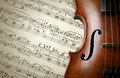 Detail of old scratched violin on music sheet collection vintage style Stock Image