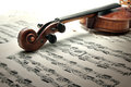 Detail of old scratched violin with sheet music collection vintage style Royalty Free Stock Photos