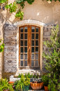 Detail of old vintage wooden window with wild roses and plants provence france Stock Photos